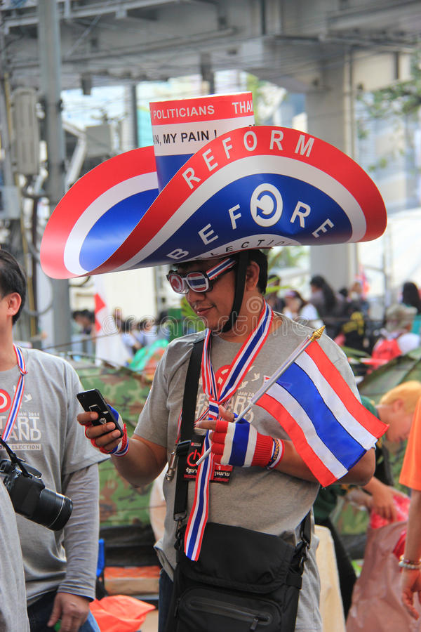 Protest against Amnesty Bill. Bangkok, Thailand - January 26, 2014: Protestors hold an anti-government rally use different many products with Thailand Flag royalty free stock image