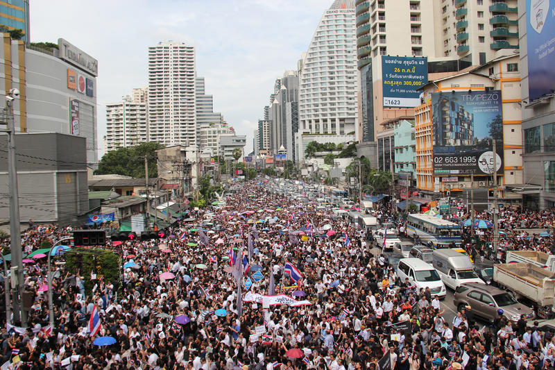 Protest against Amnesty Bill. Bangkok, Thailand - November 7, 2013: Protestors hold an anti-government rally and gather together at Asok Intersection to blow stock photography