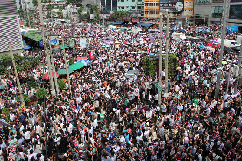 Protest against Amnesty Bill. Bangkok, Thailand - November 7, 2013: Protestors hold an anti-government rally and gather together at Asok Intersection to blow royalty free stock photos