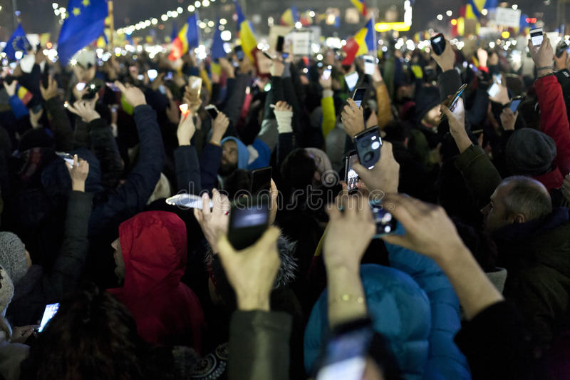 Protest against corruption reforms in Bucharest. People protesting against corruption reforms in Bucharest on 05.02.2017 stock image