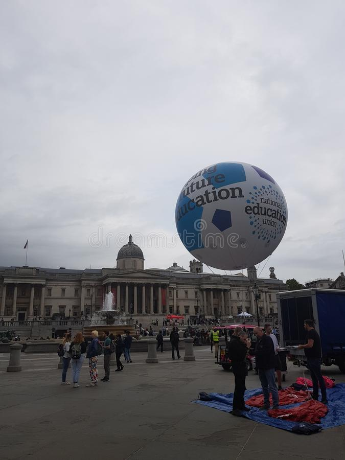 Protest against President Donald Trump State Visit in the UK. With the Trump Baby Blimp in Trafalgar Square stock photography