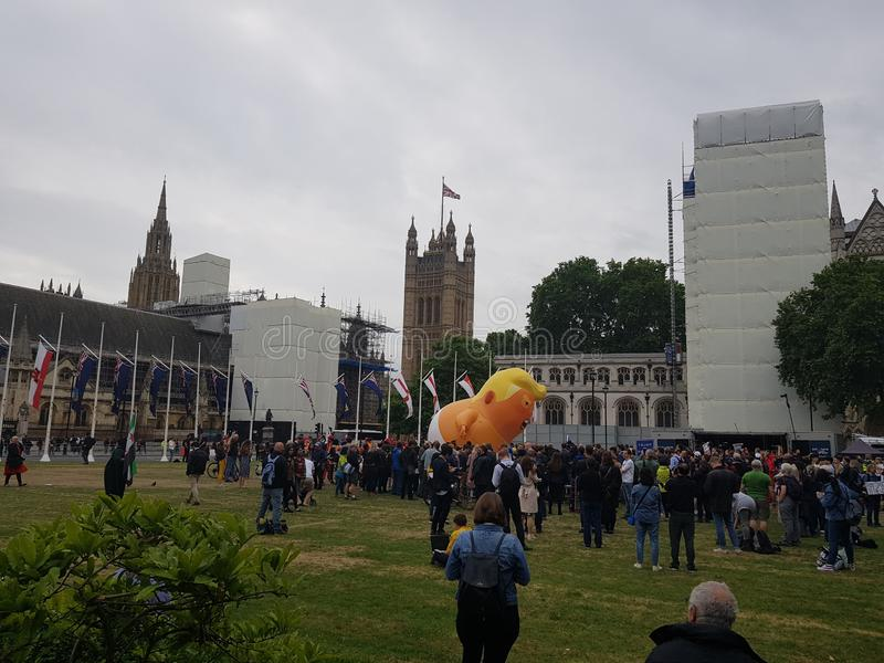 Protest against President Donald Trump State Visit in the UK. With the Trump Baby Blimp in Parliament Square royalty free stock images