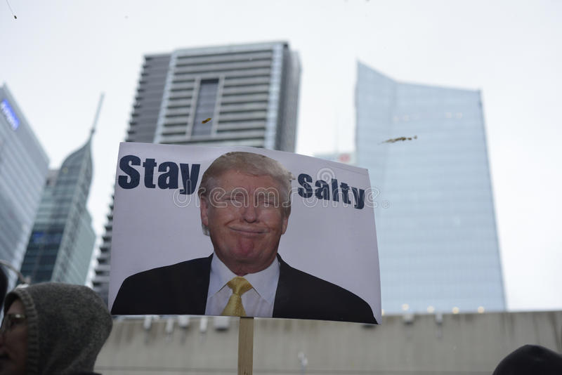 Protest in front of Trump Tower in Toronto. TORONTO - NOVEMBER 19: A funny `stay salty ` message along with the image of Donald Trump during a protest in front stock photography