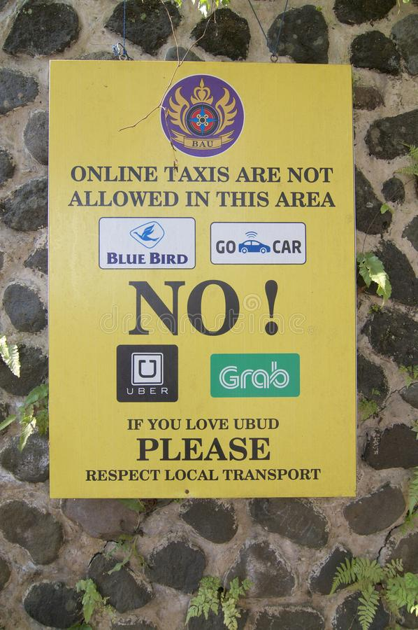 Protest sign against online taxi services in Ubud, Bali stock images