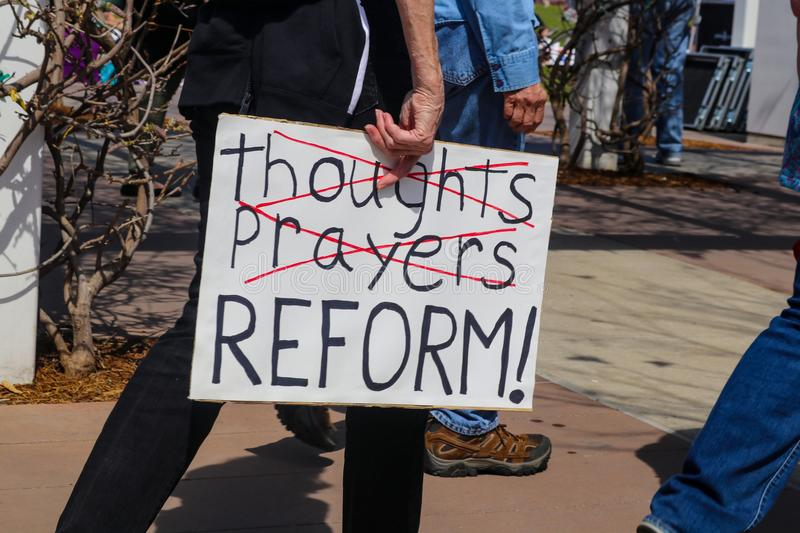 Protest sign held by participants at March for Our Lives rally stock images