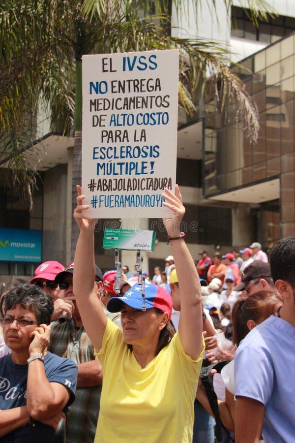 Protesta dei Venezuelans circa le scarsità della medicina immagini stock libere da diritti