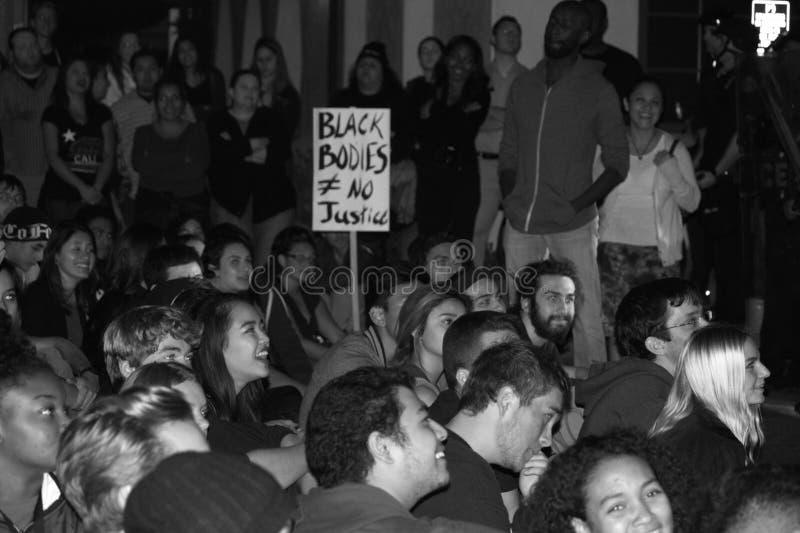 Protesta a escala nacional sobre el acto del gran jurado de Ferguson foto de archivo