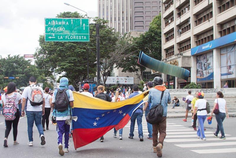 Protesteerders in Caracas tegen Venezolaanse goverments royalty-vrije stock afbeelding