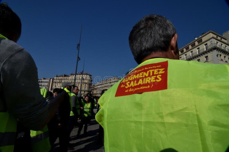 Protesteerders met gele vesten in Frankrijk stock foto