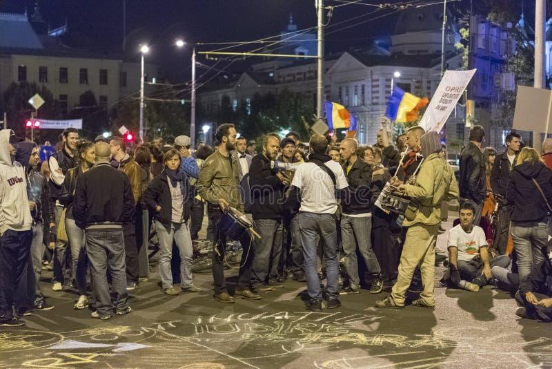 Protesten tegen cyanide gouden extractie in Rosia Montana stock afbeelding