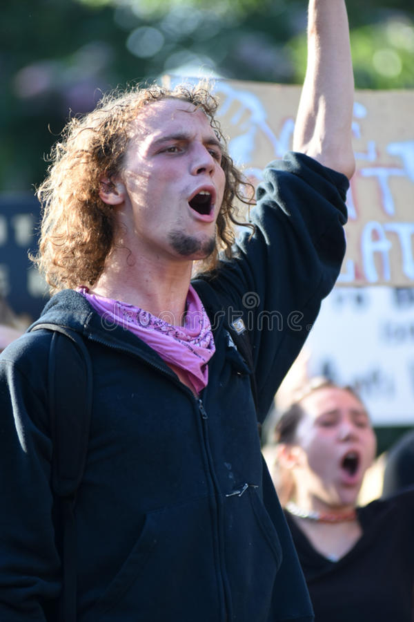 Protester addresses the crowd. stock image