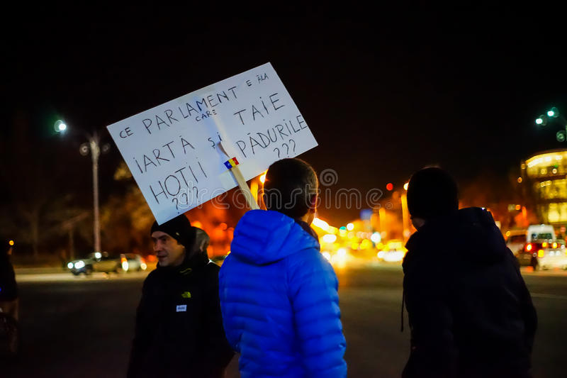 Protester with anti corruption message in Bucharest, Romania. BUCHAREST, ROMANIA - FEBRUARY 2017: The 24th day of protests. People demonstrating against royalty free stock image