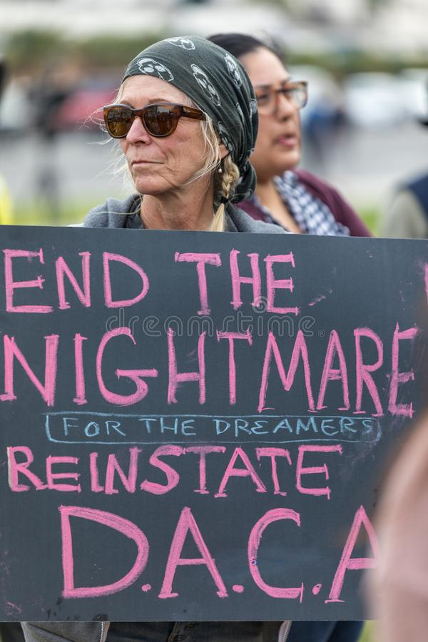 Protester holds a sign that reads End the Nightmare for dreamers. BEVERLY HILLS, CALIFORNIA - MARCH 12, 2018: A protester holds a sign that reads, ` End the stock images