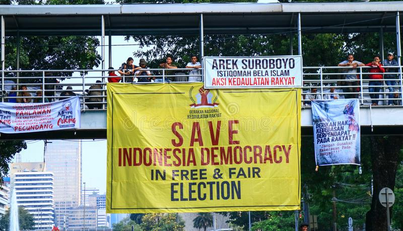 Protester`s Posters. Jakarta, Indonesia - June 27, 2019: Prabowo`s supporters put up posters on the pedestrian bridge when a demonstration near the horse statue stock images