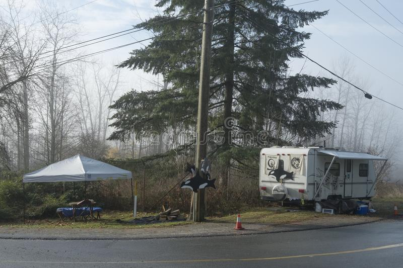Protester protests Kinder Morgan Trans Mountain Project expansion. Protester sets up camper trailer outside gates to Kinder Morgan in Burnaby, BC, to protest royalty free stock image