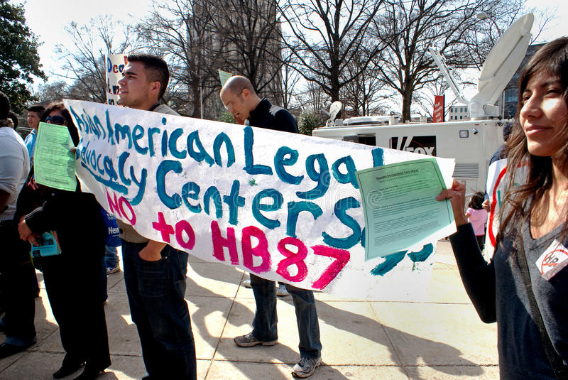 Protesters carrying sign opposing immigration bill. Photo shows demonstrators carrying a sign opposing Georgia bill HB87 also known as the Arizona copycat bill royalty free stock images