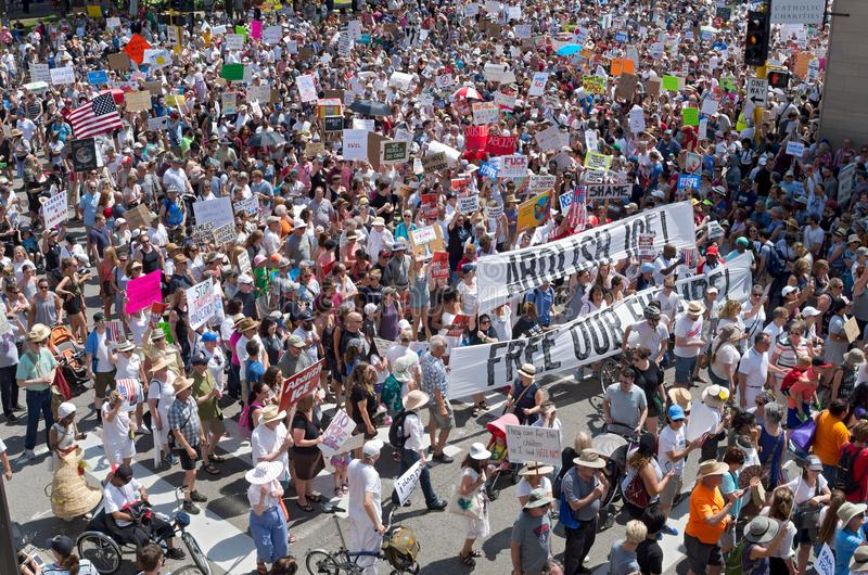 Protesters Crowd Streets at Minneapolis Rally. Minneapolis, Minnesota, USA: JUNE 30, 2018: Protesters march in the streets to support the national rally Families royalty free stock photography