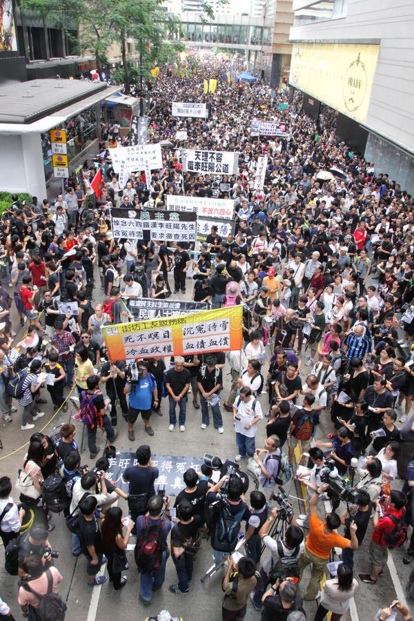 Protesters Demand Dissident Death Probe in H.K. Thousands of people have taken part in a protest march to demand a thorough investigation into the death of the stock image