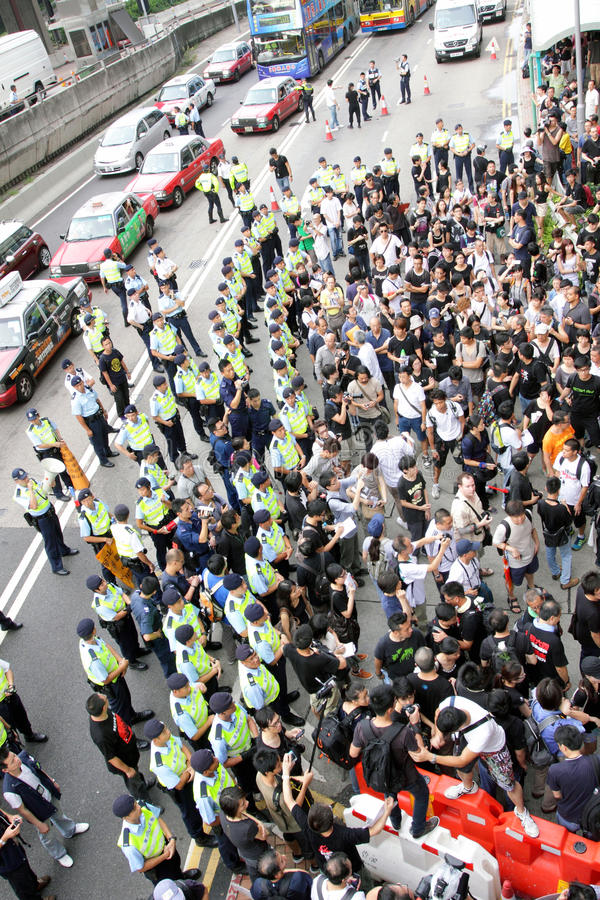Protesters Demand Dissident Death Probe in H.K. Thousands of people have taken part in a protest march to demand a thorough investigation into the death of the royalty free stock photo