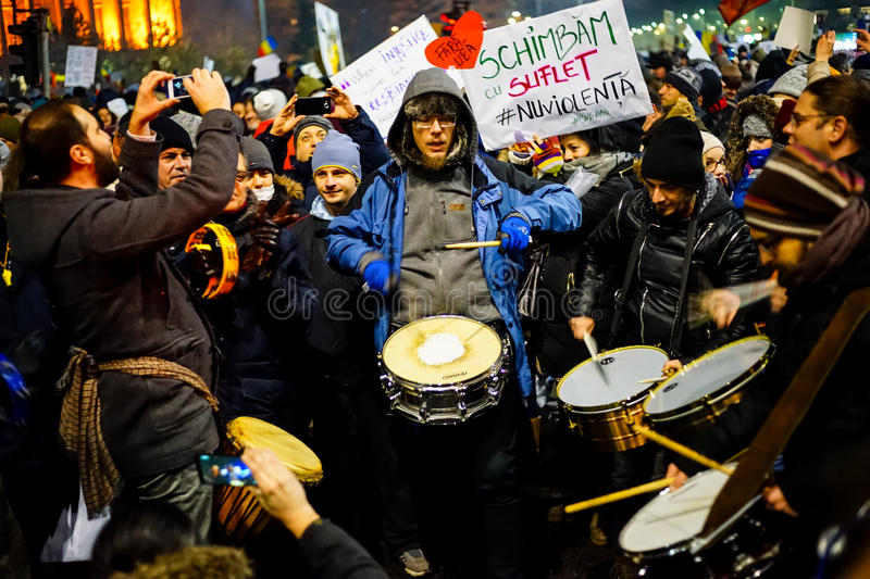 Protesters with drums, Romania. BUCHAREST, ROMANIA - FEBRUARY 2017: People demonstrating against corruption reforms gathered in front of Victoria Palace, the