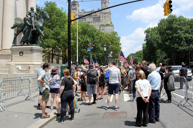 Protesters at the foot of the Theodore Roosevelt equestrian monument at the Museum of Natural History stock photo