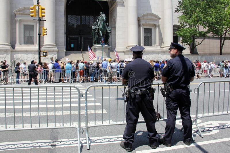 Protesters at the foot of the Theodore Roosevelt equestrian monument at the Museum of Natural History, NYPD officers observing royalty free stock image