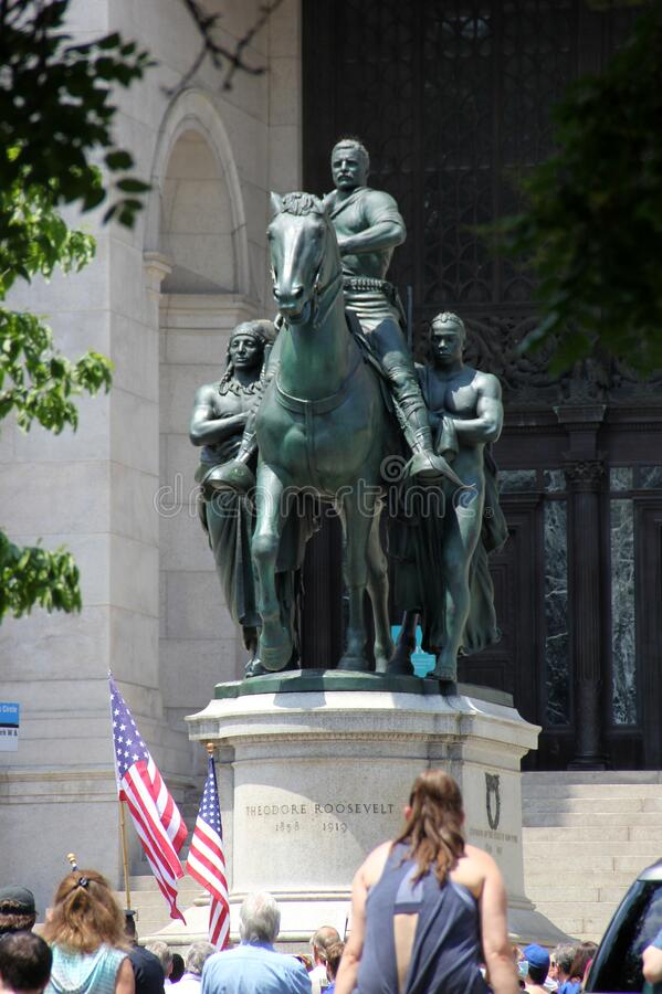 Protesters at the foot of the Theodore Roosevelt equestrian monument at the Museum of Natural History royalty free stock images