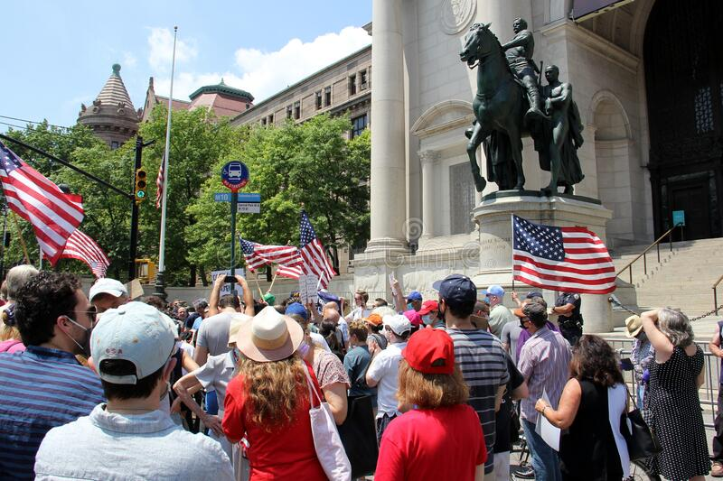 Protesters at the foot of the Theodore Roosevelt equestrian monument at the Museum of Natural History royalty free stock photos