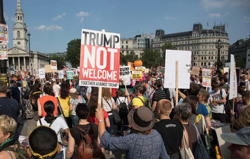 Protesters hold cards against Trump`s UK Visit royalty free stock photos