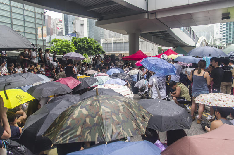 Protesters about Northeast New Territories Hong Kong. HONG KONG - JUNE 20: Protesters gathered outside the government headquarters on June 20, 2014 in Hong Kong royalty free stock photos