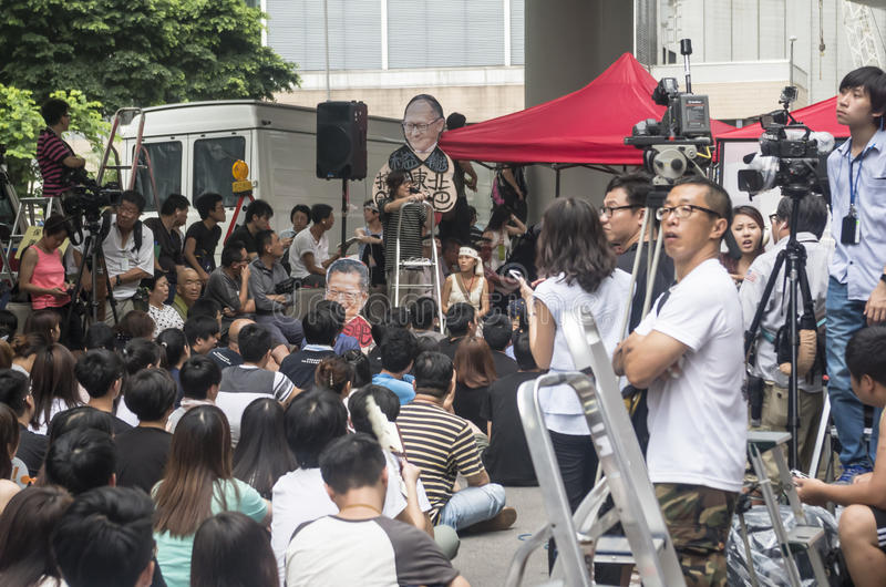 Protesters about Northeast New Territories Hong Kong. HONG KONG - JUNE 20: Protesters gathered outside the government headquarters on June 20, 2014 in Hong Kong royalty free stock photo