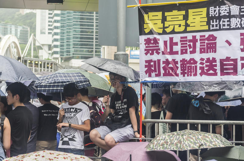 Protesters about Northeast New Territories Hong Kong. HONG KONG - JUNE 20: Protesters gathered outside the government headquarters on June 20, 2014 in Hong Kong royalty free stock photography