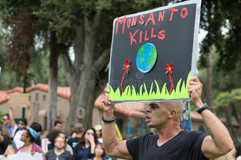 Download Protesters Rallied In The Streets Against The Monsanto Corporation. Editorial Stock Photo - Image of corporation, farming: 40955218