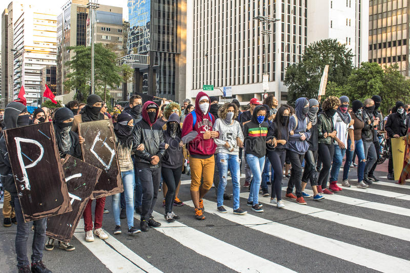 """Protesters. Sao Paulo, Brazil, September 04, 2016. Protesters participating in the protest `Fora Temer"""", Out of Temer in portuguese, against to President royalty free stock images"""