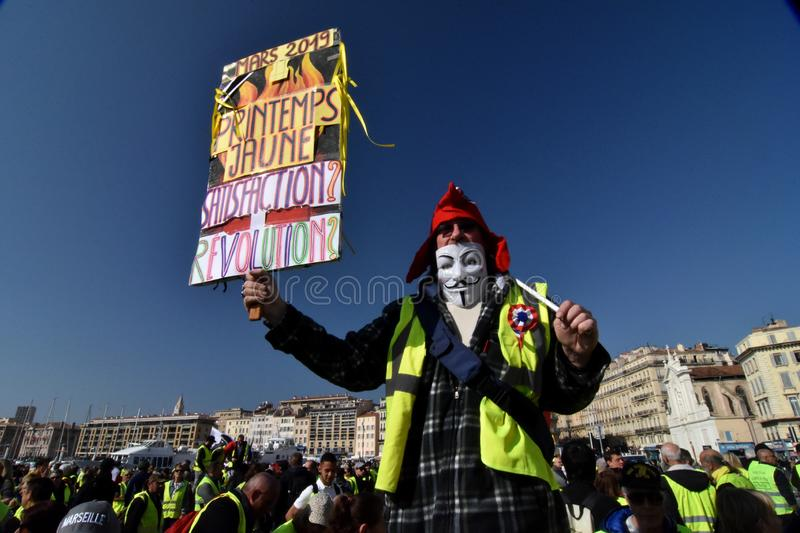 Protesters with yellow vests in France. Marseille, France - February 23, 2019 : Demonstrators with yellow vests `gilets jaunes` in french protest against the royalty free stock photos