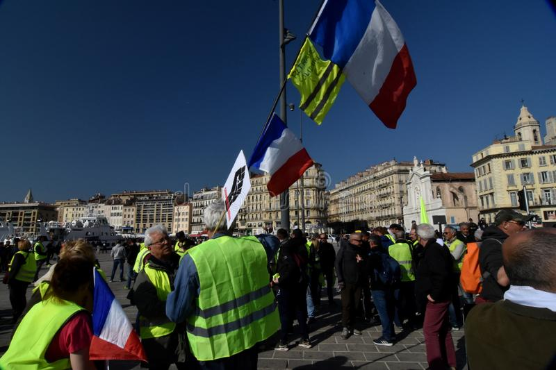 Protesters with yellow vests in France. Marseille, France - February 23, 2019 : Demonstrators with yellow vests `gilets jaunes` in french protest against the stock photography