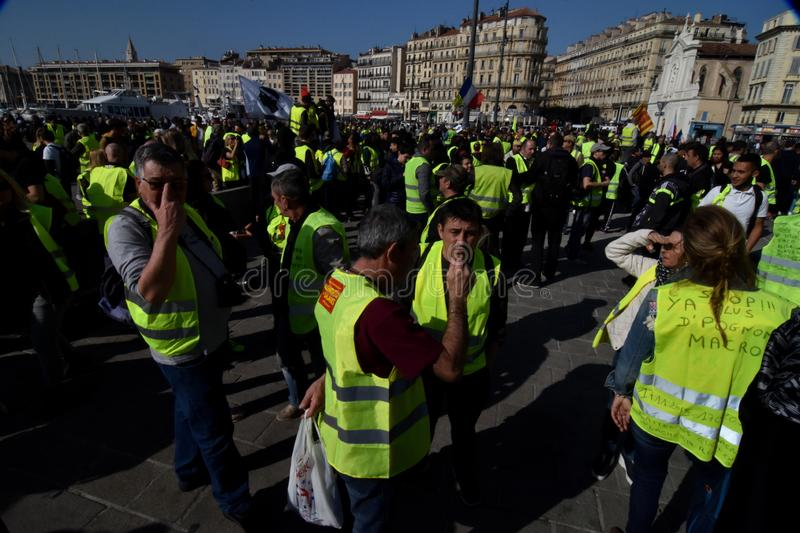 Protesters with yellow vests in France. Marseille, France - February 23, 2019 : Demonstrators with yellow vests `gilets jaunes` in french protest against the stock image