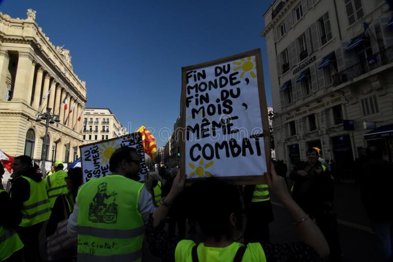 Protesters with yellow vests in France. Marseille, France - February 23, 2019 : Demonstrators with yellow vests `gilets jaunes` in french protest against the royalty free stock images