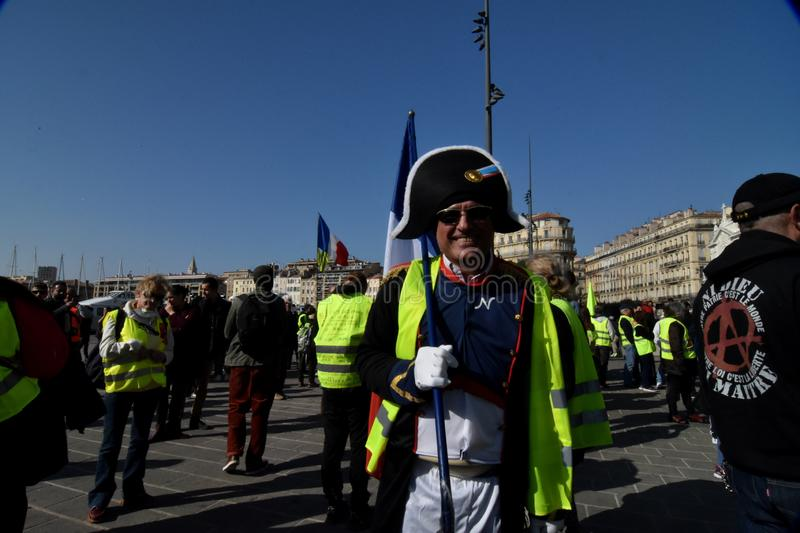 Protesters with yellow vests in France. Marseille, France - February 23, 2019 : Demonstrators with yellow vests `gilets jaunes` in french protest against the stock photos