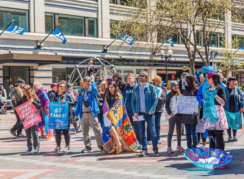 Protestors in Seattle. SEATTLE, WASHINGTON - May 13, 2017: Logging was Seattle`s first major industry, but this has long been replaced by shipping, tourism royalty free stock photo