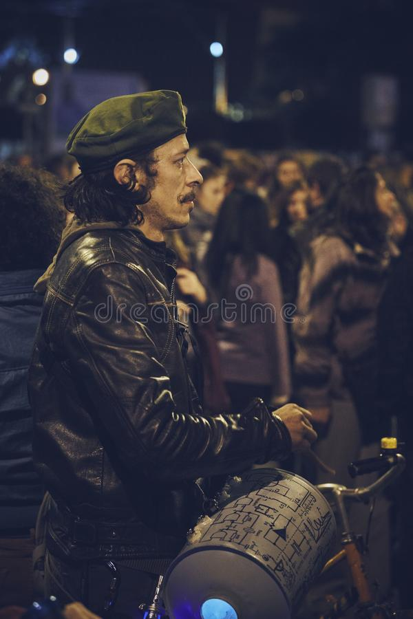 Protests against Rosia Montana gold mine, Bucharest, Romania. Bucharest, Romania - October 6, 2013: Man protester loudly plays the drum during the population stock photo