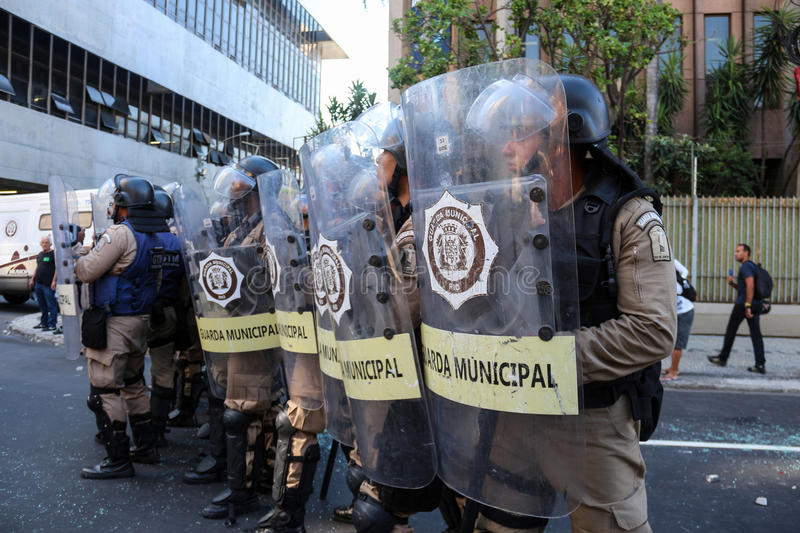 Protests in Rio de Janeiro has violence and damage to Carnival s. Rio de Janeiro, Brazil, February 20, 2017: Police officers use non-lethal weapons, morale bombs royalty free stock image