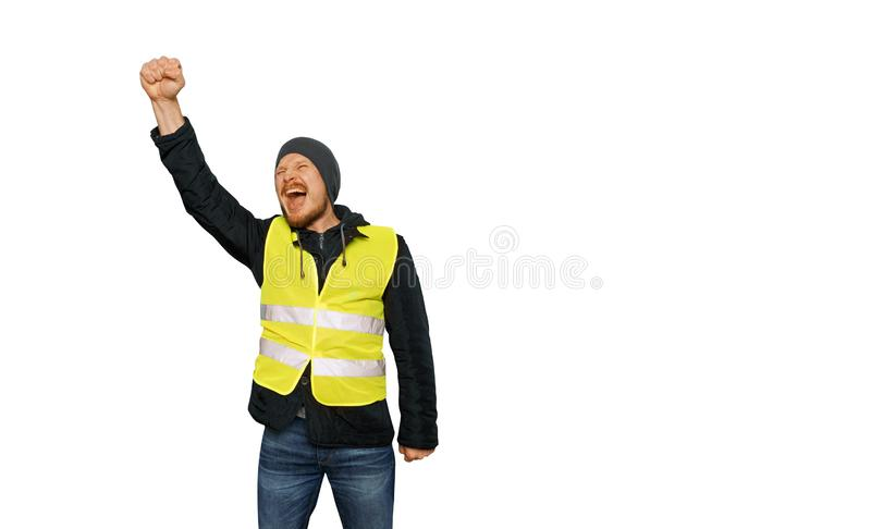 Protests yellow vests. Man raised his hand into a fist and shouted on isolated. Protests yellow vests. The man raised his hand into a fist and shouted. The stock image