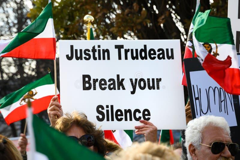 Protesty w solidarności z irańskimi protestującymi wzywają Justina Trudeau obraz royalty free