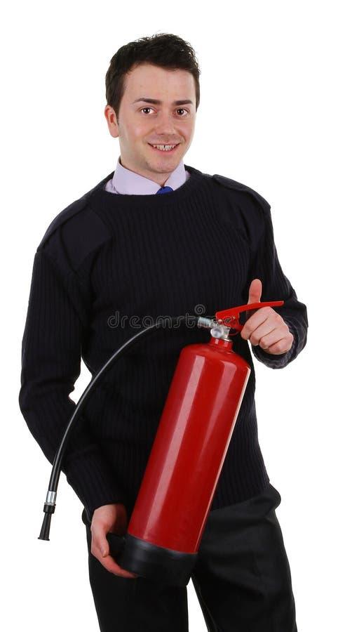 Protetor de segurança com um extintor de incêndio imagem de stock royalty free