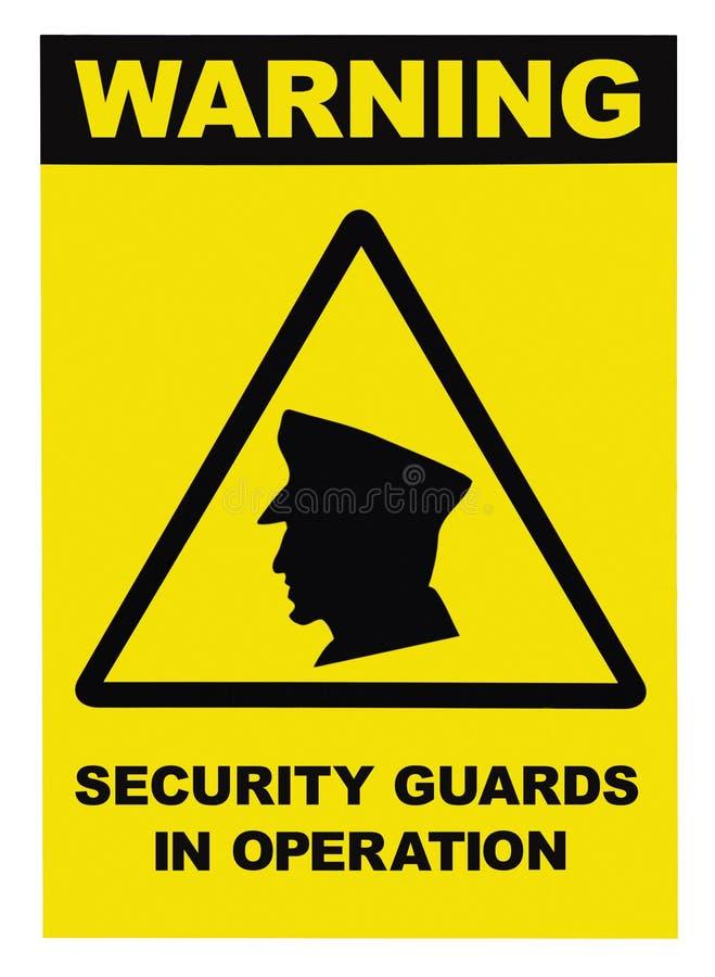 Protetores de segurança no sinal de aviso do texto da operação imagens de stock royalty free