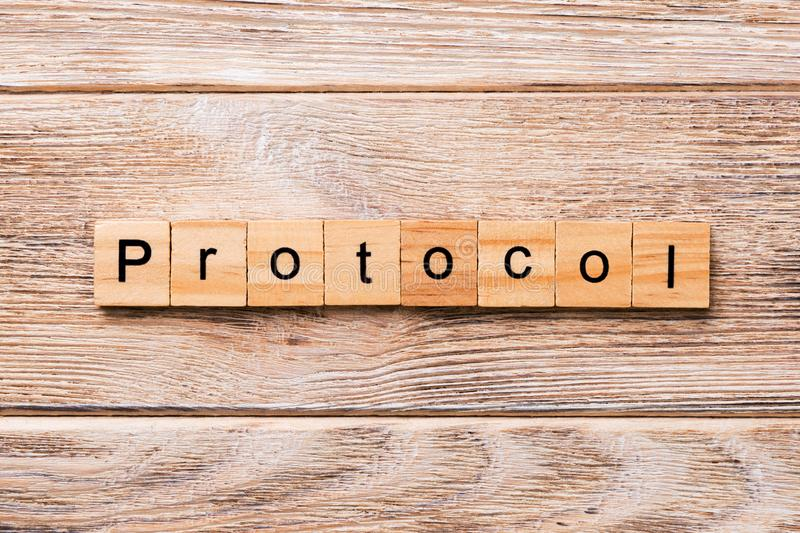 PROTOCOL word written on wood block. PROTOCOL text on wooden table for your desing, concept.  stock image