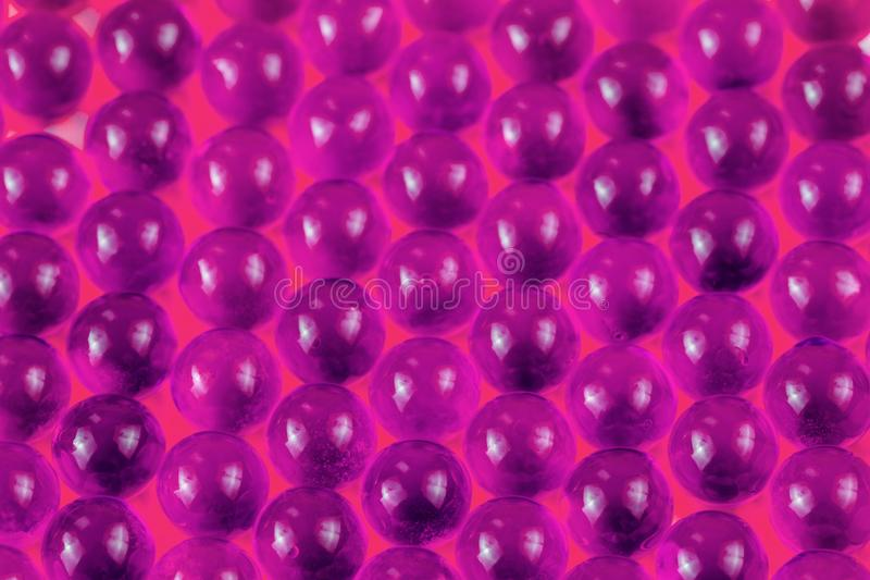 Proton purple spherical ball capsules selective focus weird abstract background stock photography