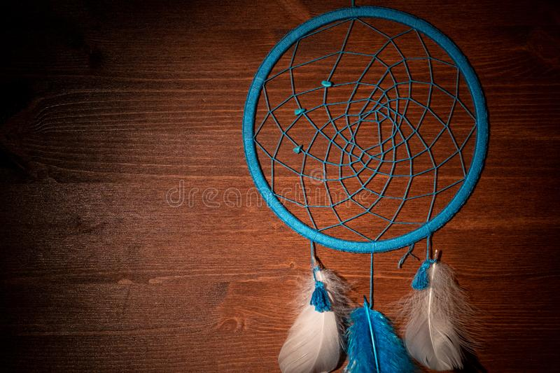 Protruding from the darkness dream catcher blue of blue thread, handmade royalty free stock photos
