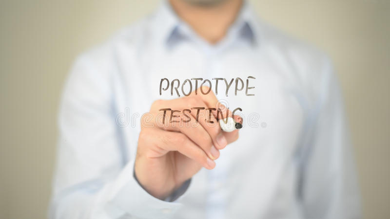 Protype Testing , Man writing on transparent screen. High quality royalty free stock image